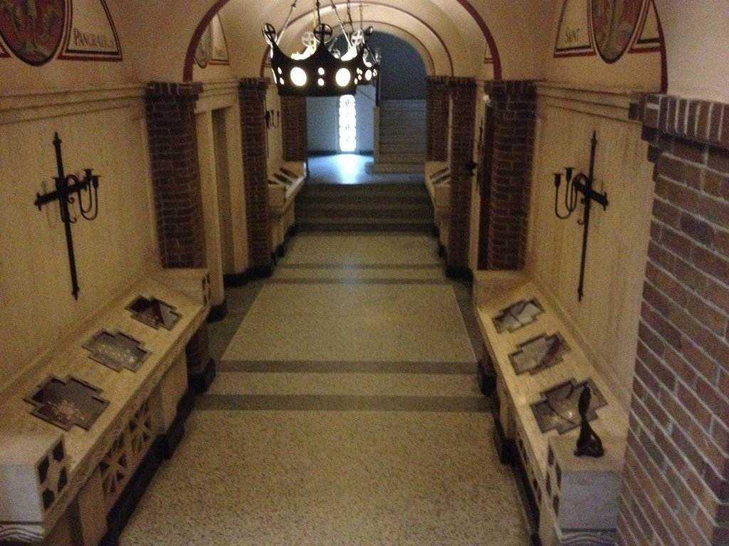 The hallway in the Church basement where the relics are exposed in marble and glass displays.
